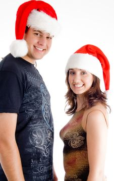 Couple With Christmas Hat And Looking At Camera Royalty Free Stock Photos