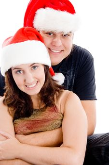 Couple With Christmas Hat And Looking At Camera Stock Images