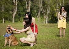 Free Girlfriends Outdoor In The Park With Pet Dogs Stock Photography - 8433892