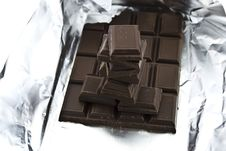 Free Broken Chocolate On A Foil Royalty Free Stock Image - 8436236