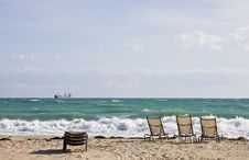 Free Chairs On Beach And Freighter Royalty Free Stock Images - 8439609