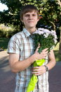 Free Boy Presenting Flowers Royalty Free Stock Image - 8449856