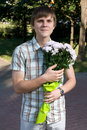 Free Boy Presenting Flowers Royalty Free Stock Photos - 8449948