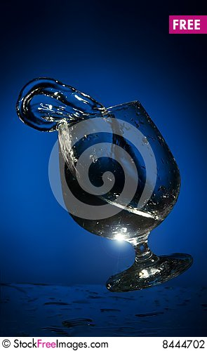 Free Big Splash Of Fluid In A  Glass Stock Photography - 8444702