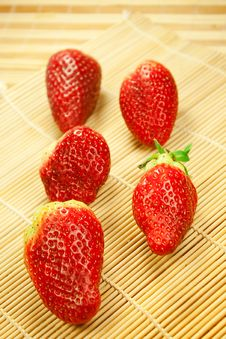 Strawberries On A Bamboo Mat Royalty Free Stock Image