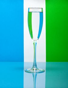 One Wineglass On Color Background Stock Photos