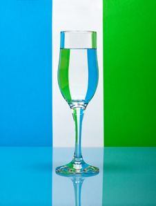One Wineglass On Color Background Royalty Free Stock Photo