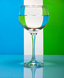 One Wineglass On Color Background Royalty Free Stock Image