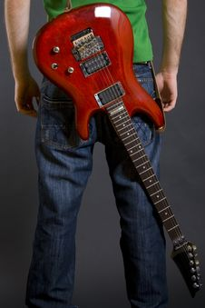 Isolated Guitar On The Back Of A Man Royalty Free Stock Photo