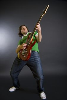 Passionate Guitarist Playing His Electric Guitar Royalty Free Stock Photos