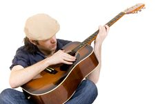 Guitarist Playing An Acoustic Guitar Seated Royalty Free Stock Photo