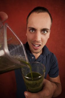 Free Young Man With Unappetizing Health Shake Royalty Free Stock Image - 8443986