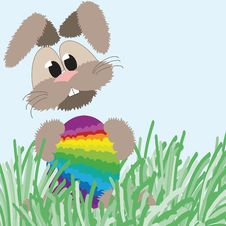 Happy Fluffy Bunny And Easter Rainbow Egg Stock Image