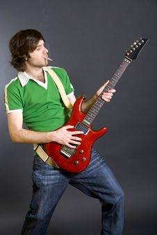 Passionate Guitarist Playing His Electric Guitar Stock Photo