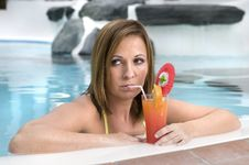 Beautiful Woman With Cocktail In A Swimming Pool Stock Photos