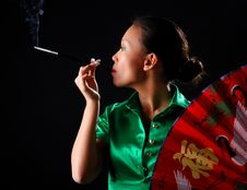 Free Woman With Cigarette And Fan Stock Photo - 8445900