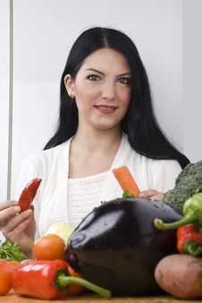 Woman In Kitchen With Vegetables Royalty Free Stock Images