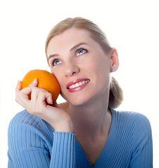 Beautiful Girl With An Orange Royalty Free Stock Photo