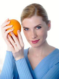 Beautiful Girl With An Orange Royalty Free Stock Image
