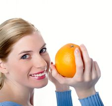 Free Beautiful Girl With An Orange Stock Images - 8447154