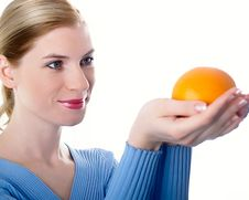 Free Beautiful Girl With An Orange Royalty Free Stock Image - 8447166