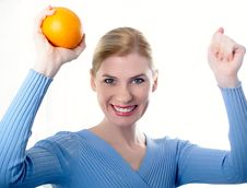 Beautiful Girl With An Orange Royalty Free Stock Images