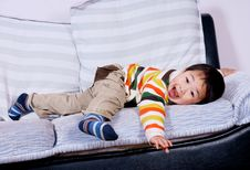 Free Boy Playing On Sofa Stock Photos - 8449643