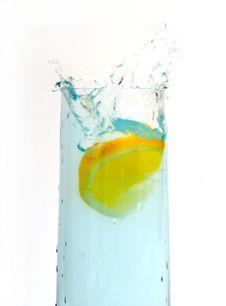 Free Lemon Splashing Into Glass Royalty Free Stock Image - 8451846