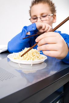Free Hungry Boy Eating Chinese Noodles With Sticks Stock Images - 8452074