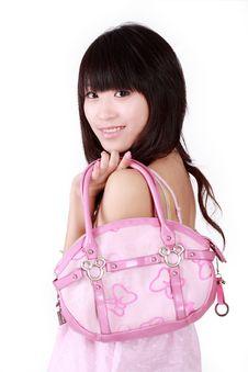Asian Girl With Pink Handbag Stock Photos