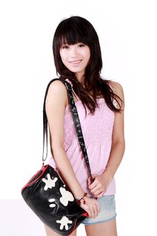 Free Asian Girl With Pink Handbag Royalty Free Stock Photo - 8456325