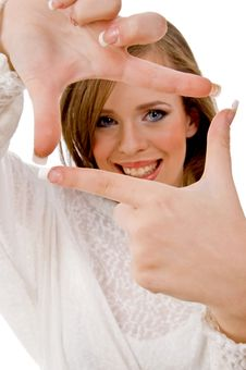 Smiling Female Showing Framing Hand Gesture Stock Photo