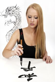 Free Woman Writing Chinese Calligraphy: Peace Stock Photo - 8456660