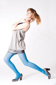 Free Teenager In Blue Pantyhose And Grey Blouse Posing Stock Photography - 8457752