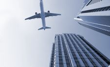 Free Airplane And The Modern Building Royalty Free Stock Photos - 8458398