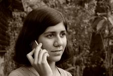 Girl Taking The Call. Stock Photography