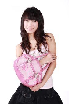 Asian Girl With Pink Handbag Royalty Free Stock Image