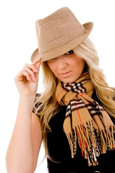 Portrait Of Smiling Young Woman Holding Her Hat Stock Images
