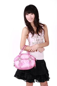 Free Asian Girl With Pink Handbag Stock Photography - 8459472