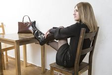 Free Young Blond Woman In Black Dress Sitting On Chair Royalty Free Stock Photo - 8464125