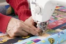 Free Quilter Threading Needle. Royalty Free Stock Images - 8466089