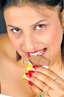 Free Girl Eating Chocolate Royalty Free Stock Photography - 8466867