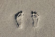 Two Footprints In The Sand Stock Photo