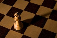 Queen Dramatically Isolated On Chess Board Royalty Free Stock Photography