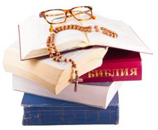 Free Open Bible With Rosary And Glasses Isolated Stock Photography - 8469922