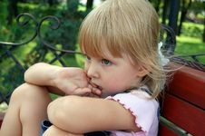 Little Girl Sit And Wait Stock Image