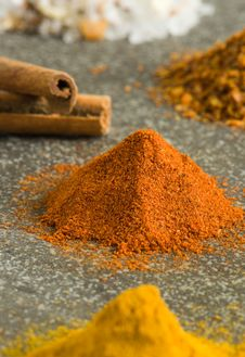 Piles Of Ground Spices On Grey Background Royalty Free Stock Images