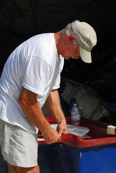 Free Man Reparing Boat Royalty Free Stock Photos - 8478908