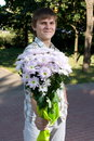 Free Boy Presenting Flowers Stock Image - 8485331