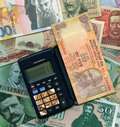 Free International Currencies With Calculator. Stock Photography - 8488002